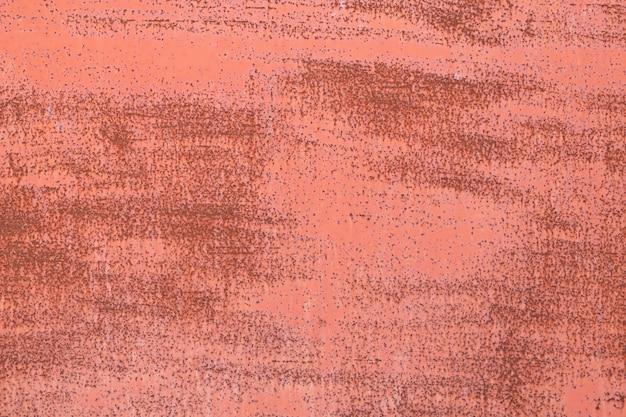 Vecchio fondo di struttura della superficie del metallo verniciato rosso arrugginito Foto Premium