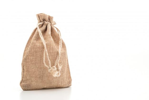 Borsa in tessuto a sacco su superficie bianca Foto Premium