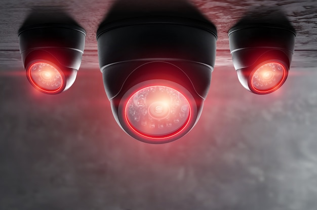 Telecamera cctv intelligente sotto il soffitto con luci rosse. Foto Premium