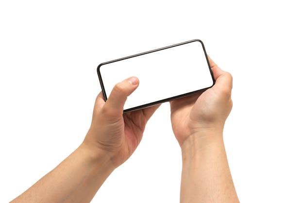 Smart phone in mano d'uomo isolato Foto Premium