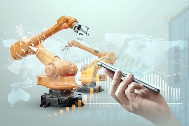 Smartphone in mano d'uomo e braccia robotiche di un impianto moderno. concetto di tecnologia iot, fabbrica intelligente. operazione di produzione digitale. industria 4.0. Foto Premium