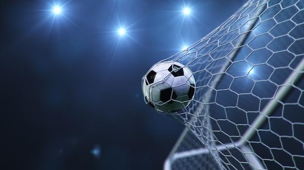 Il pallone da calcio è volato in porta. Foto Premium