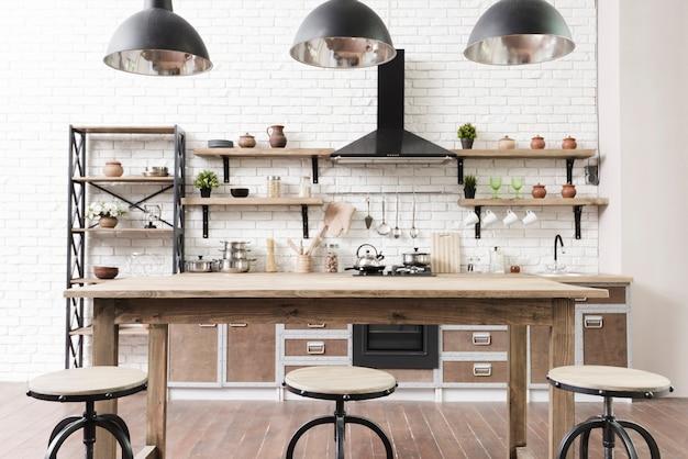 Zona cucina moderna ed elegante con isola Foto Premium