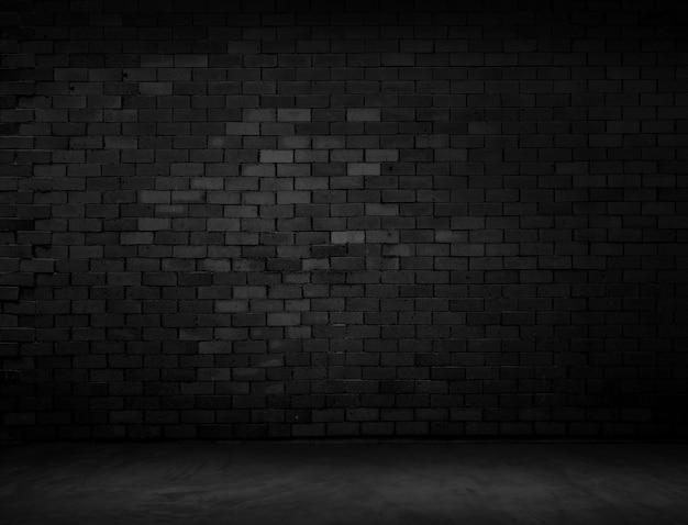 La superficie del mattone scuro frastagliata Foto Premium