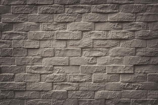 Superficie della priorità bassa del muro di mattoni dell'annata per la progettazione nel vostro lavoro concetto del contesto di struttura. Foto Premium