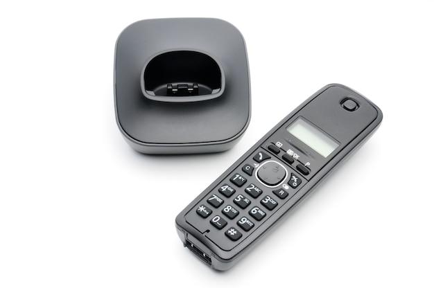 Cornetta telefonica per chiamate verso linee urbane e interurbane su fondo bianco Foto Premium