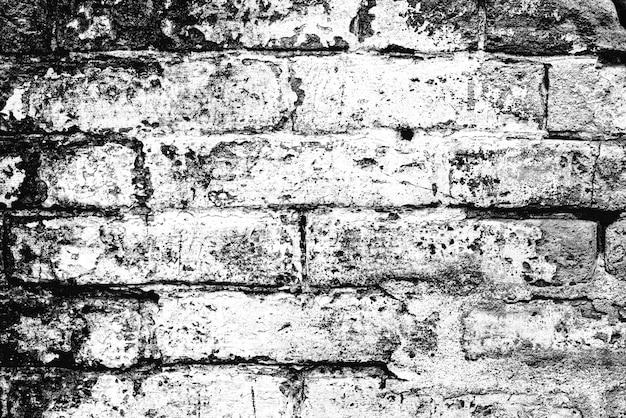 Trama di un muro di mattoni con crepe e graffi che possono essere utilizzati come sfondo Foto Premium