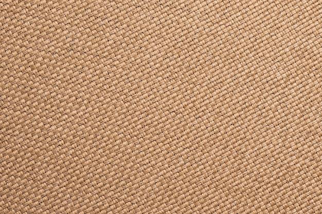 Trama di tela, sfondo marrone tessuto. superficie della tela di sacco, materiale di licenziamento, primo piano di carta da parati tessile insaccante Foto Premium