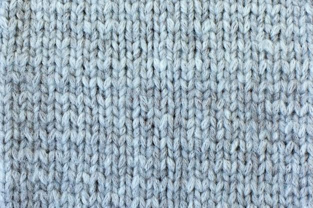 La trama di un tessuto di lana a maglia grigio. sfondo Foto Premium