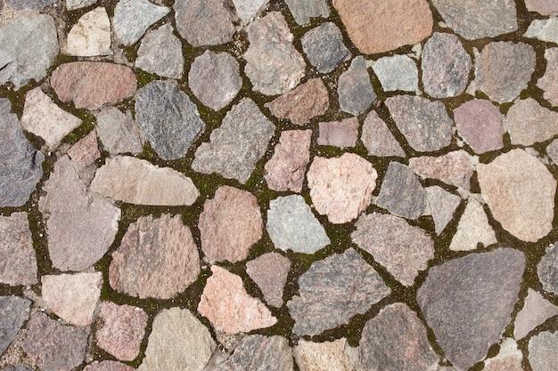 Texture di pavimentazione in pietra piastrelle acciottolato sfondo di mattoni Foto Premium