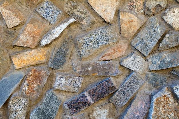 Texture di pietre di diversi colori, mattoni e cemento Foto Premium