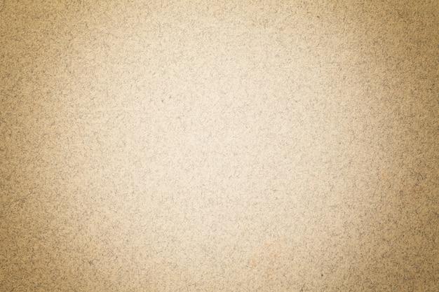 Struttura del fondo di carta marrone chiaro d'annata con la scenetta opaca. struttura in cartone kraft beige con cornice. Foto Premium