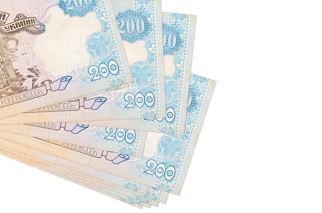 Le fatture ucraine di hryvnias si trovano in piccolo mazzo o pacchetto isolato su bianco Foto Premium
