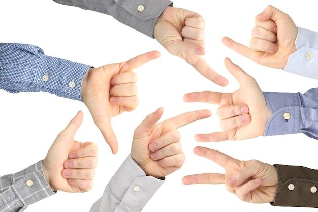 Vari gesti delle mani maschili tra loro su un bianco. Foto Premium