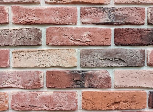 Il muro è una superficie di mattoni rossi. muro astratto. Foto Premium