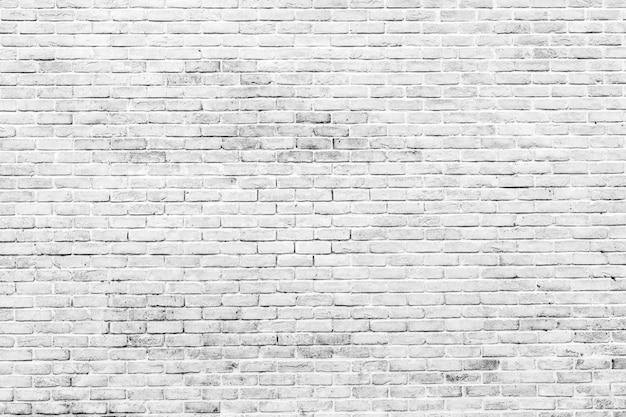 Fondo bianco e grigio di struttura del muro di mattoni Foto Premium
