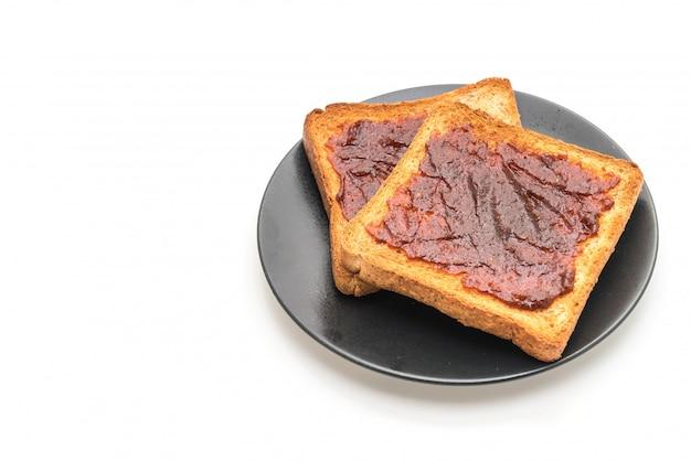 Pane tostato integrale con pasta di peperoncino Foto Premium