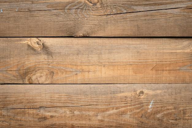 Pannello in legno, trama del tavolo in rovere. tavole di legno, scrivania in legno. doghe marroni, sfondo muro. superficie del legno, modello di registro. Foto Premium