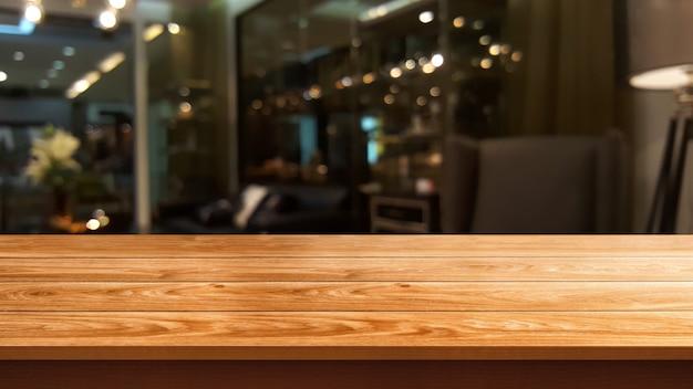 Tavola di legno nel fondo della sfuocatura del ristorante moderno Foto Premium