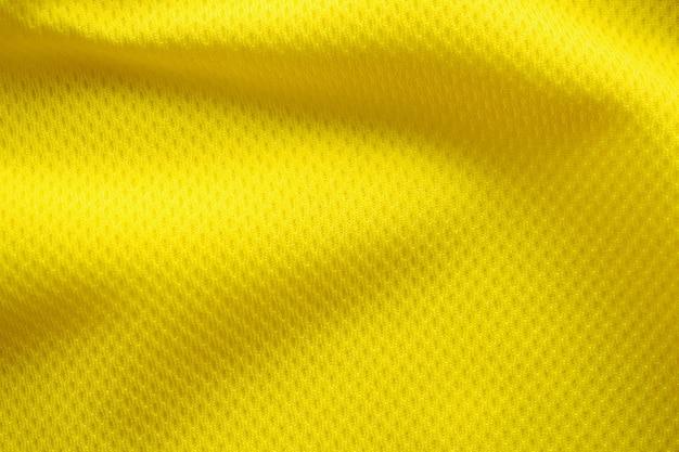Colore giallo maglia da calcio abbigliamento tessuto trama abbigliamento sportivo sfondo, vicino Foto Premium