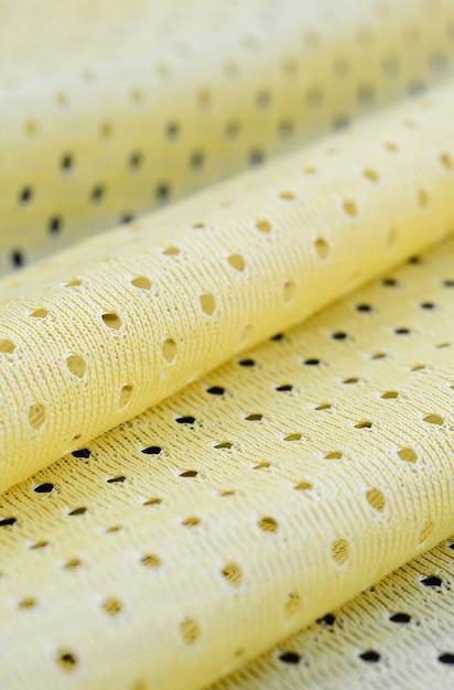 Modello giallo del fondo del tessuto del tessuto di usura di sport della maglia Foto Premium