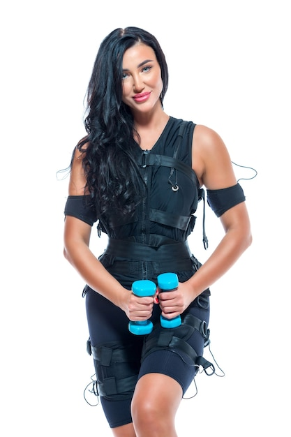 Una giovane donna atletica in una tuta ems Foto Premium