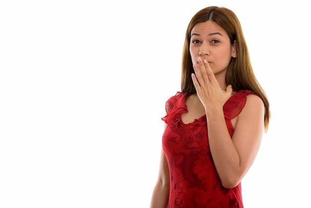 Giovane bella donna che sembra scioccata Foto Premium
