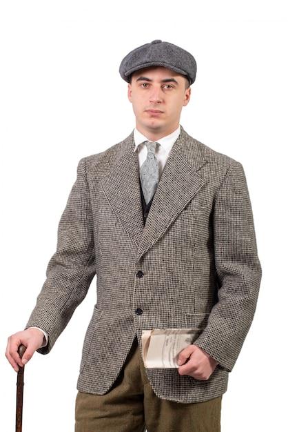 Giovane in abiti retrò con cappello Foto Premium