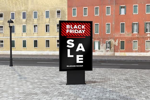 Mockup del cartello stradale del tabellone per le affissioni con la bandiera di vendita del black friday Psd Premium