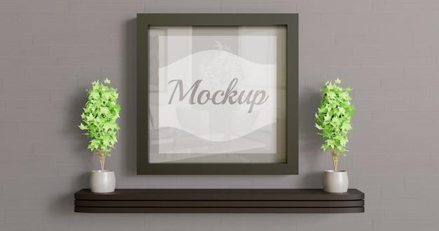 Mockup cornice quadrata nera sul muro con piante decorazione coppia. logo, foto, mockup d'arte Psd Premium