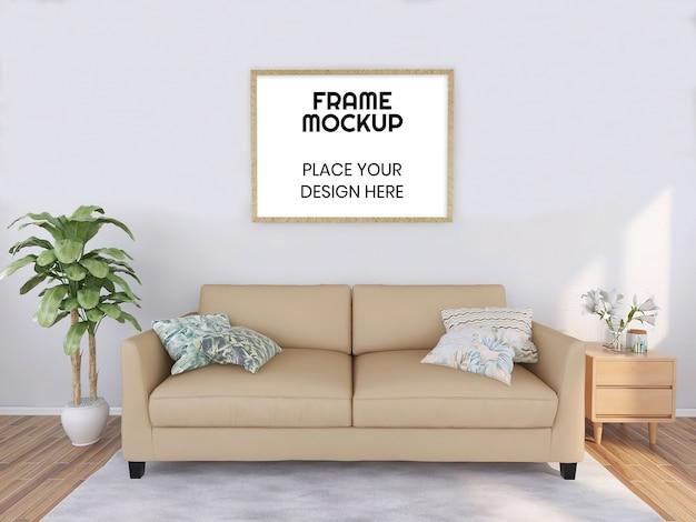 Mockup di cornice vuota con divano pianta e crema Psd Premium
