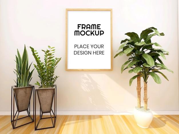 Mockup di cornice vuota con pianta Psd Premium