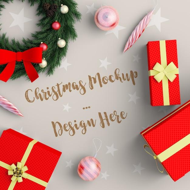 Decorazione natalizia con mockup di scatola regalo rossa Psd Premium