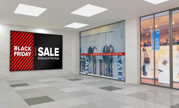 Display cartello sul muro mockup nel centro commerciale con banner di vendita del black friday Psd Premium