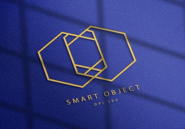 Design elegante mockup logo su tessuto denim blu Psd Premium