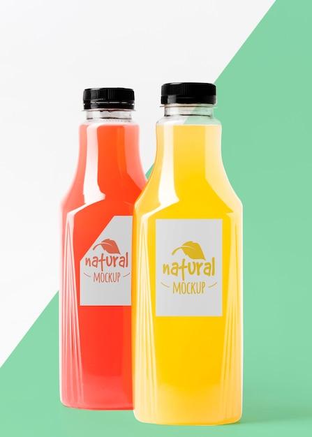 Vista frontale dell'assortimento di bottiglie di succo trasparenti Psd Premium
