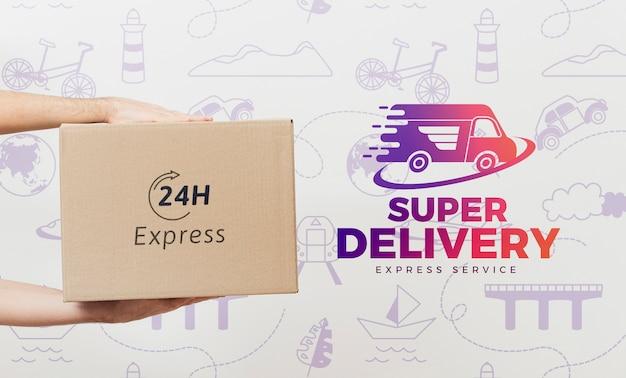 Mani che tengono scatola mock-up Psd Premium