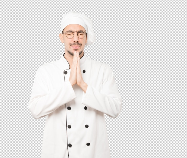 Gesto di preghiera felice giovane chef Psd Premium