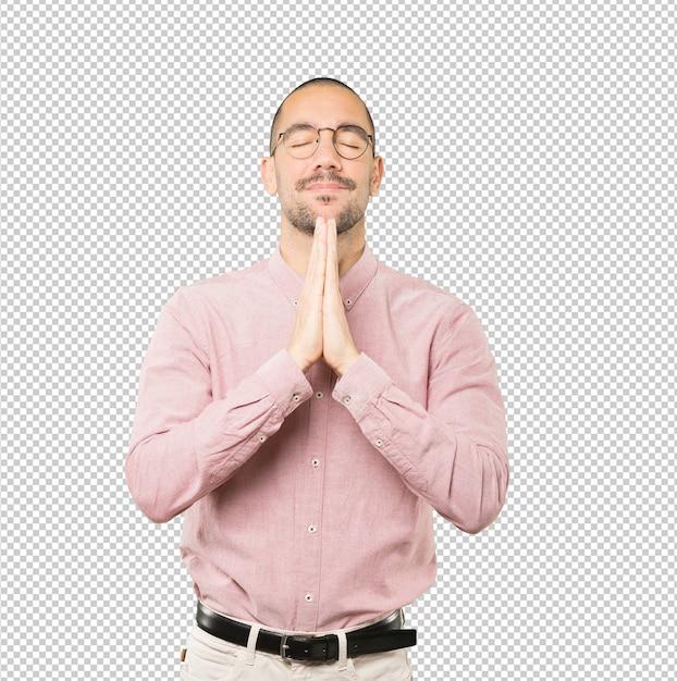 Gesto di preghiera felice giovane Psd Premium