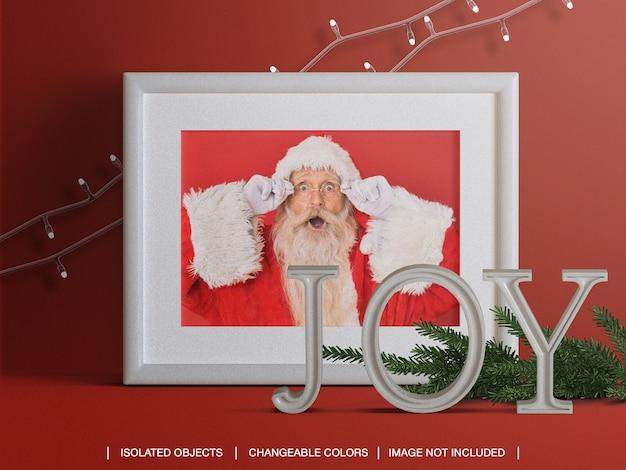 Mockup di cornice per foto di vacanze con ramo di natale e decorazioni di luci Psd Premium