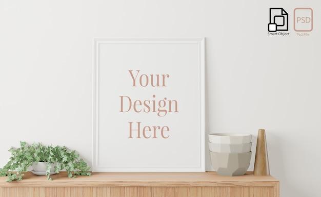 Poster interno casa mock up con cornice sulla credenza e sfondo bianco muro. rendering 3d. Psd Premium