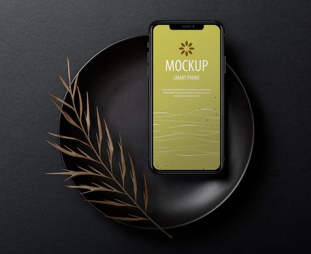 Modello di mockup schermo iphone con foglie secche Psd Premium