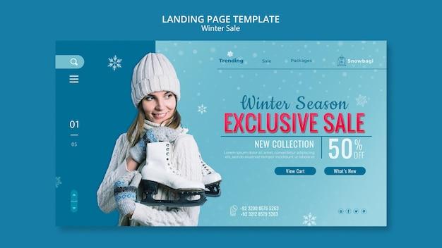 Modello di pagina di destinazione per la vendita invernale con donna e fiocchi di neve Psd Premium