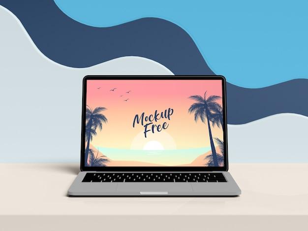 Computer portatile sul concetto di estate della tavola Psd Premium