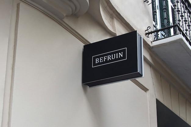 Logo mockup modern black hang sign Psd Premium