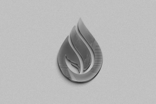 Logo metallico su uno sfondo grigio Psd Premium