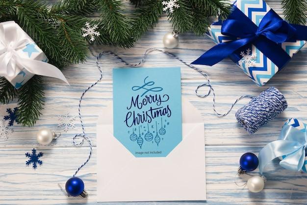 Mockup biglietto di auguri di natale e regali Psd Premium
