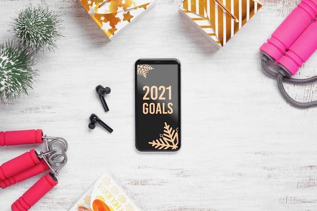Mockup cellulare per risoluzioni di capodanno obiettivi sani concetto di sfondo Psd Premium