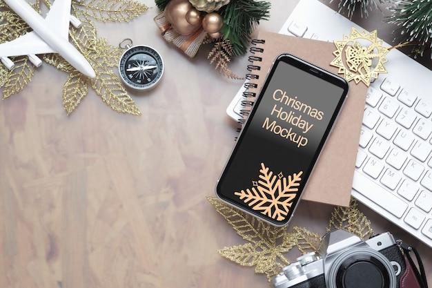 Smartphone di mockup per il concetto di sfondo di viaggio di natale capodanno vacanza Psd Premium