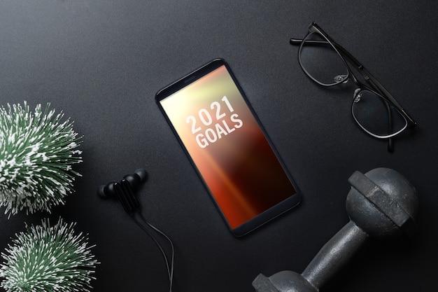 Smartphone mockup per risoluzioni o obiettivi di capodanno per uno stile di vita sano Psd Premium